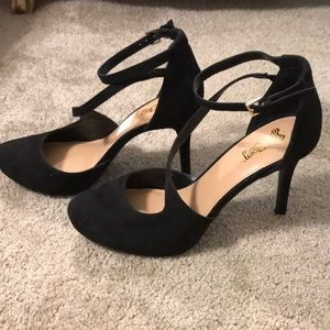 Black closed toe strapped heels